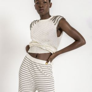 Sleeveless textured knit top with contrasting details on shoulders
