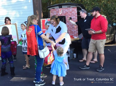 """Trunk or Treat is popular with my grandchildren, shown here with their """"SuperWoman"""" Mom (and it's a fitting costume!)."""