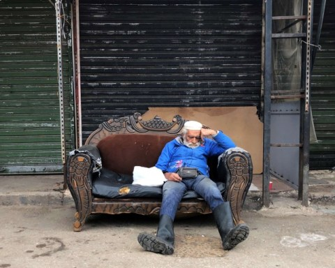 Poor Man sitting on a couch