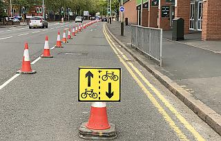 [photo of pop-up protected bike track]