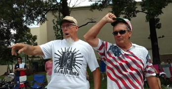 4th of July parade watchers threatning marchers with 2nd Amendment
