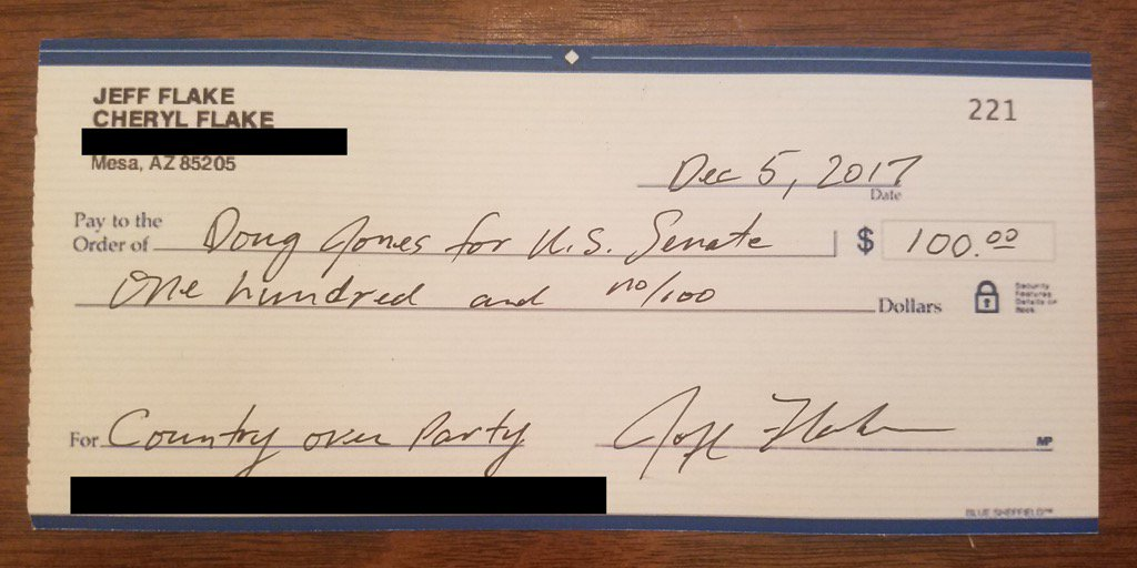 Republican Jeff Flake Check to Doug Jones