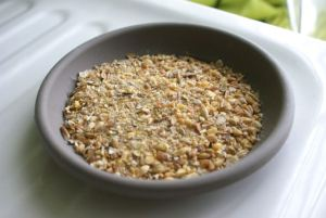 Bowl of crushed and whole grain for baby chicks