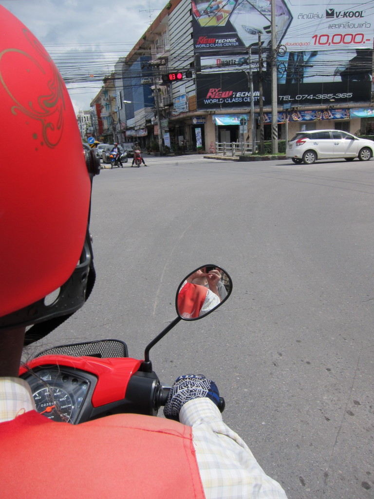 An awkward photo from the back of a motorbike waiting for traffic lights.