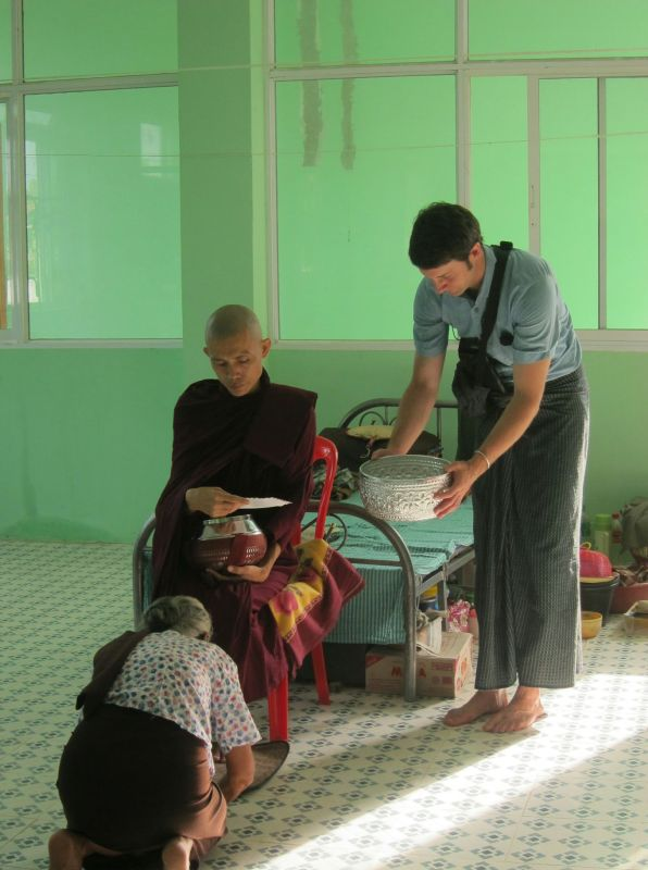 A worshiper in a health care facilty (on site) offering Sayadaw an envelope. The guy holding the money pot is Felix, who was from Germany. He spoke very good Burmese and was our unofficial guide to learning the language, how to order food, which places in Myanmar were great to visit, how to wear a longhi, some of the more complex rituals around buddhism, and so much more. In fact, a very interesting post all about Felix will be written soon.