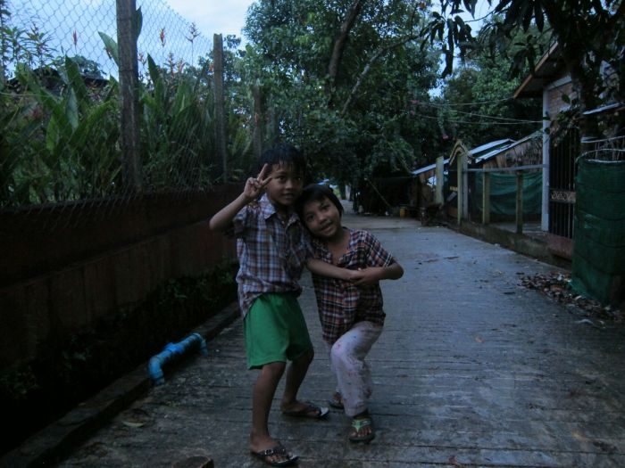These kids were playing the (possibly traditional?) Burmese game of 'pick up the rock and smash it on the ground'. When we walked past they paused the game and asked for a photo.