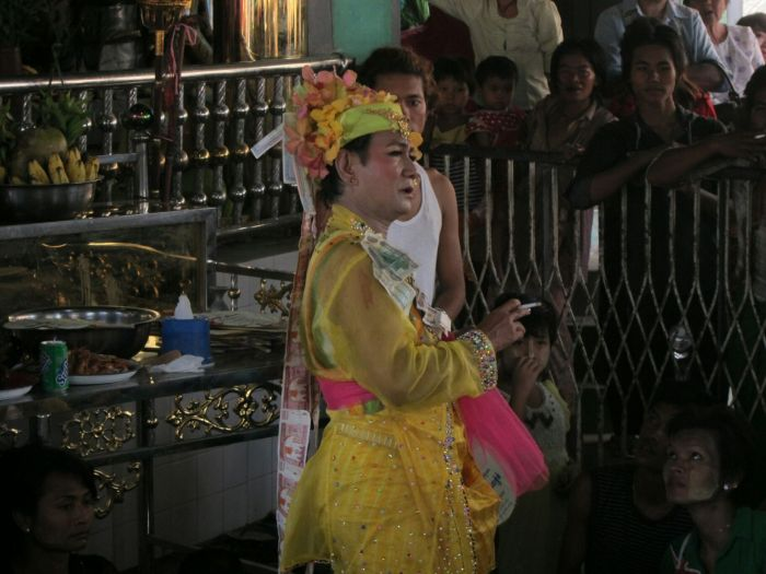 A lady-boy performance. The one in yellow was decked out n cash (real cash) and periodically threw fistfulls of it at the eager crowd. The header picture above is my favourite photo, taken while the dancer is mid-throw.