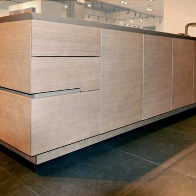 sandlbasted and smoked oak finished cabinetry featured in the eggersmann florida german kitchen showroom