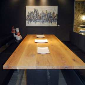 natural wood long dining table by eggersmann white ultra modern kitchen by eggersmann featured on display at studio Toronto