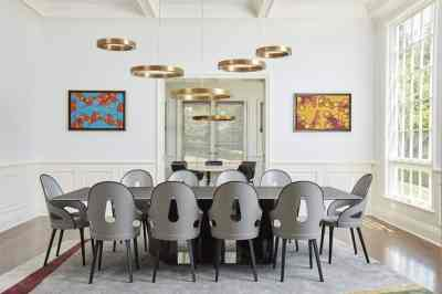 stylish contemporary dining room remodel project featuring a unique brass ring chandelier as shown in modern reduction in california home magazine