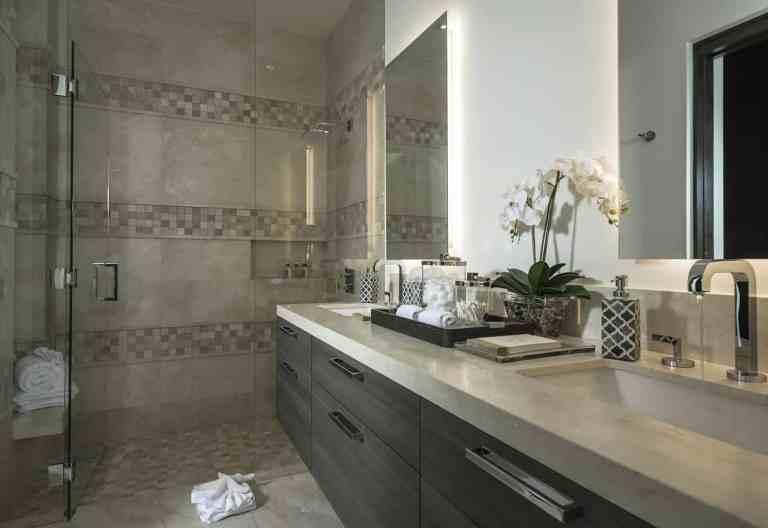 warm stone and dark woods create a cozy but modern bathroom using custom designs by eggersmann