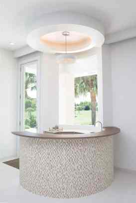 stone mosaic clad circular bar makes just the right touch of elegance in a space perfect to entertain in