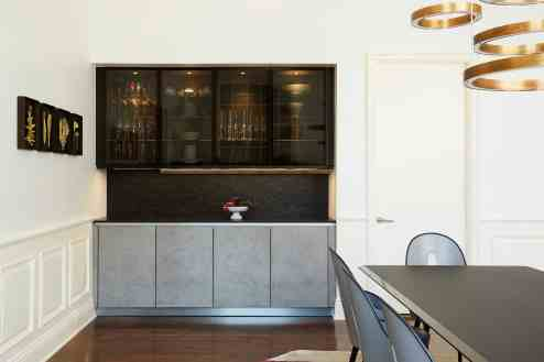 modern cabinetry serves as a functional buffet in this luxurious but more traditional home