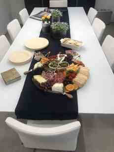 Cheese and relish tray designed by food stylist , Meg Quinn, set on the eggersmann LA showroom dining table