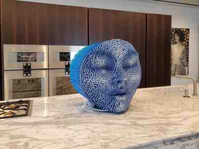 curated art exhibition at eggersmann dallas featured this blue moon head sculpture by robert mars