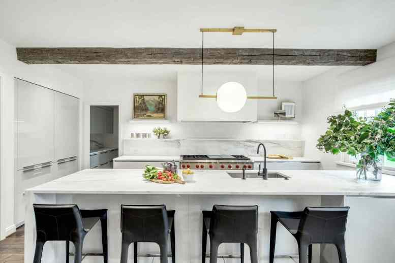 ultra-modern eggersmann german kitchen featured in a parisian apartment style remodel of a home in the Houston Museum district