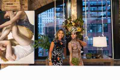 guests with featured artwork in the eggersmann kitchens chicago showroom during the rndd gallery walk 2019
