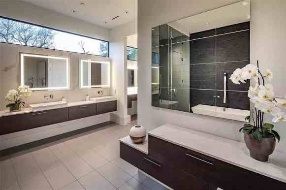 floating vanities in the master bathroom of a tanglewood home