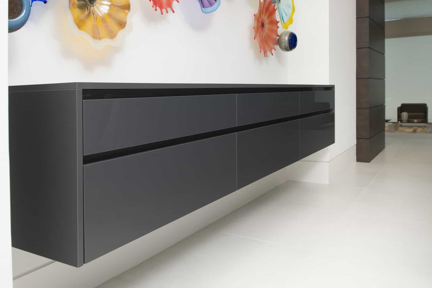 floating credenza designed by eggersmann offers ample storage in the dining room of this contemporary home