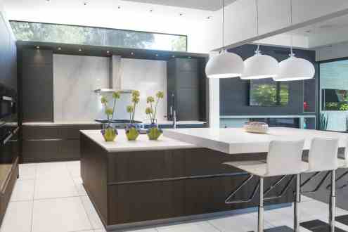 ultra-modern eggersmann kitchen island with integrated breakfast counter in caesarstone quartz