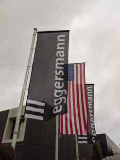 eggersmann factory tour flags in front of factory include eggersmann logo and us flag