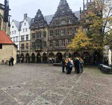 plaza surrounded by baroque architecture in muenster germany