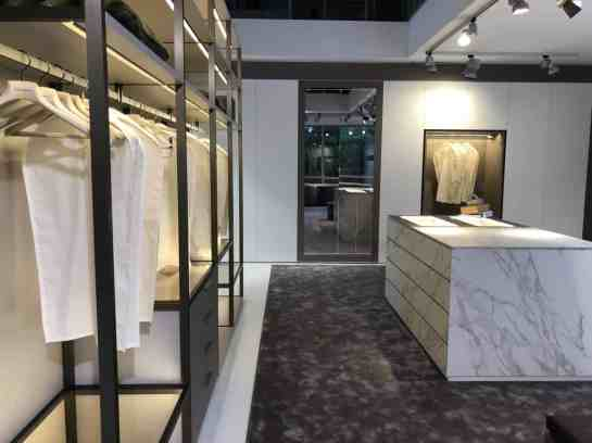 schmalenbach factory tour porcelain finish on island in custom walk-in closet