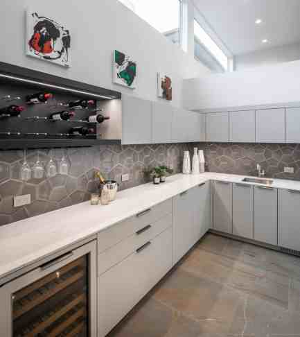 high-end white german cabinets of a newly renovated washington coalition memorial park area home in houston