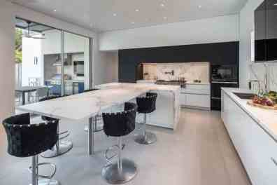 eggersmann houston black and white kitchen with lots of light for an upper kirby new construction home
