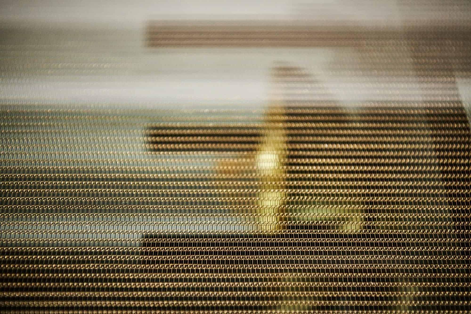 eggersmann' interlink bronze finish is bronzed steel link chains embedded in glass