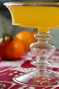 A glass of quince vodka mixed with clementine juice and prosecco