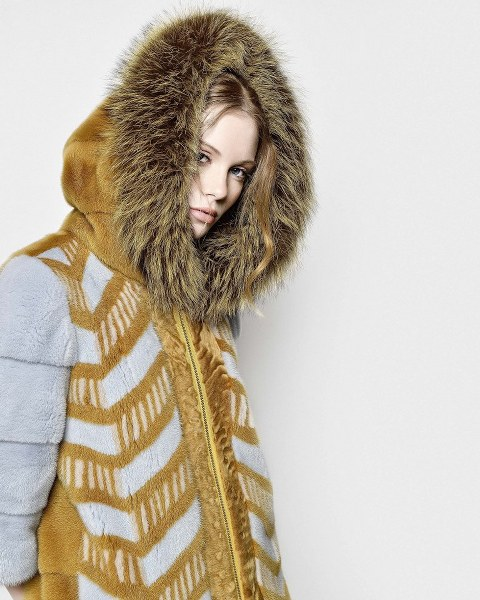 gold mink coat with grey details and fox hoodie