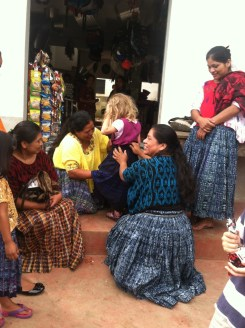 Some ladies helping Esther adjust her too-long skirt