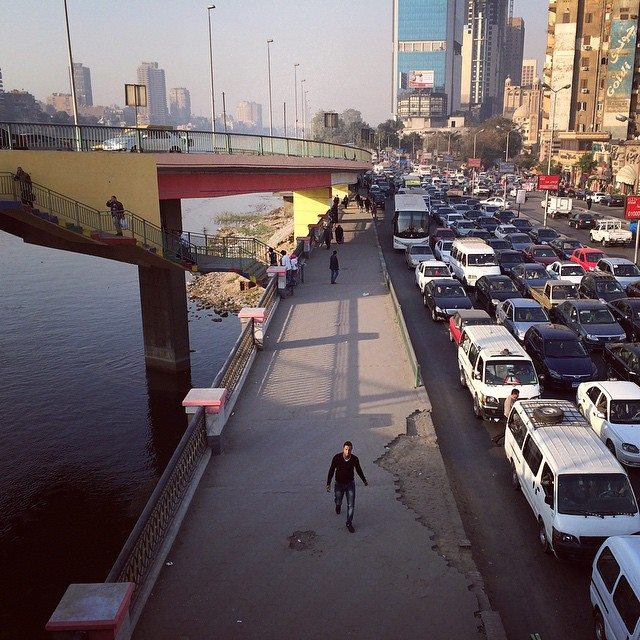 Often times, it makes more sense to just walk than to get stuck in one of Cairo's traffic jams. Photo by Tinne Van Loon