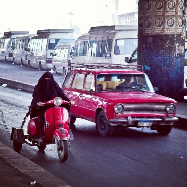 A veiled woman driving a motorbike in Cairo. Photo by Roger Anis
