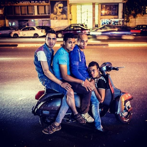 Egyptian youth riding a 'vesba' in Cairo. Photo by Roger Anis