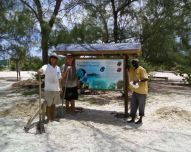 Steven Cole, Robert Williams, and Semy of Good Hope, Ltd installed a sign at Chat N Chill.