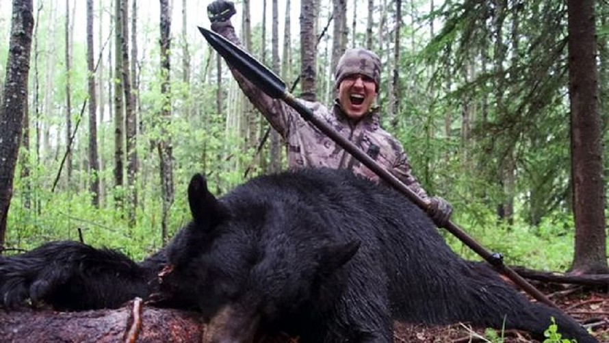 Hunter Kills Bear With Spear And Under Armour Kills