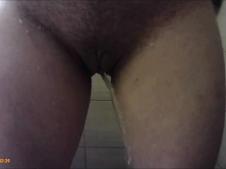 Milf with small tits pissing in shower