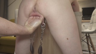 Extreme fisting with weight on her pierced labia hard play