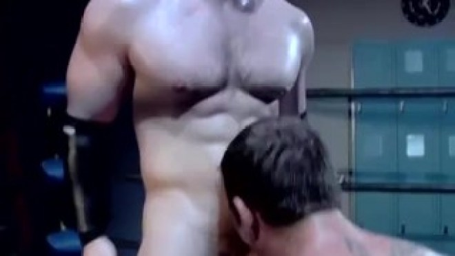 Two hunky wrestlers suck each other off in the ring
