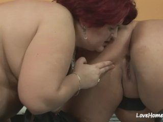Two big pretty ladies are pleasuring each other