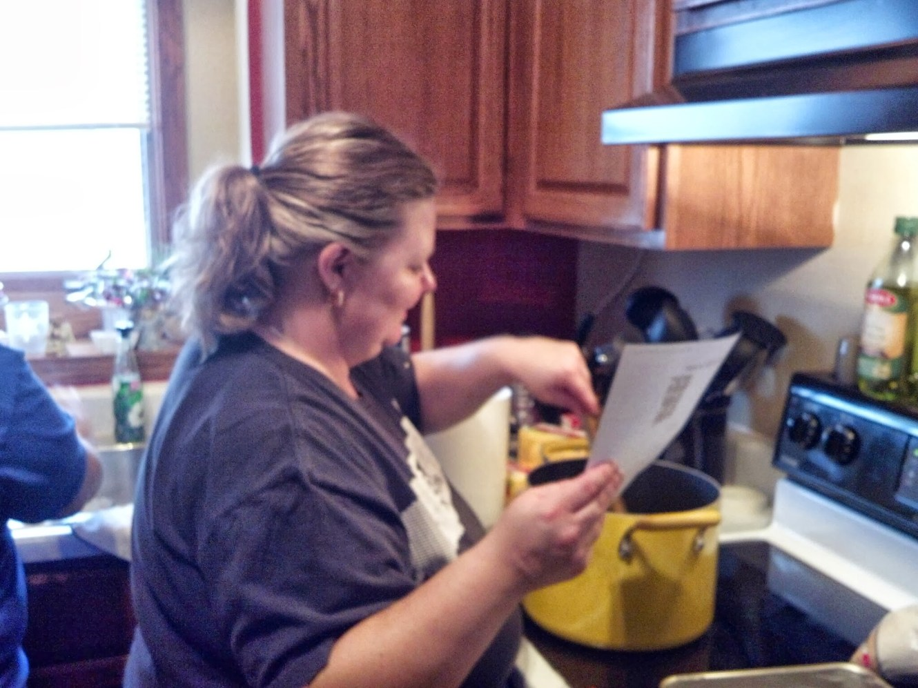 Ann stirs something. I don't know, I didn't ask. Maybe it has something to do with cookies.