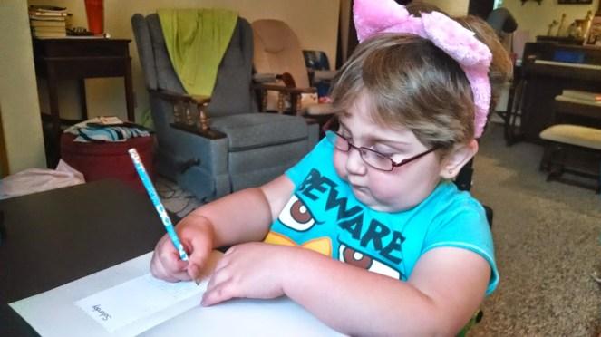 Cat ears while doing homework. Everybody needs cat ears.