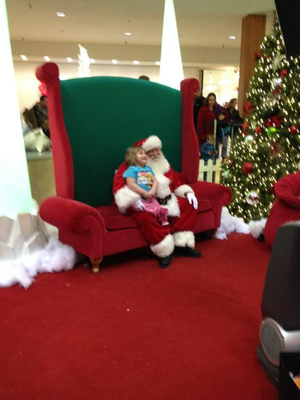 "Namine sitting on what she called ""pretend Santa's lap."""