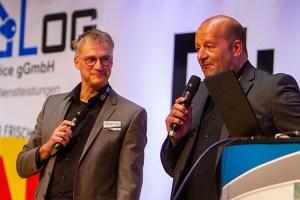 """Konnten eine Erfolgsgeschichte sowohl menschlich wie wirtschaftlich erzählen: Seit zehn Jahren zeichnet sich """"EuLog"""" nicht nur durch Inklusion von Menschen mit Behinderungen aus, sondern hat sich in der Branche auch als zuverlässiger Logistikpartner bewiesen, wie Georg Richerzhagen, Geschäftsführer NEW, und Markus Wilden, Geschäftsführer """"EuLog"""", sagten. Bild: Tameer Gunnar Eden/Eifeler Presse Agentur/epa"""
