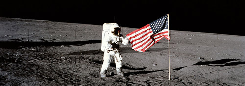 Astronaut on moon with flag