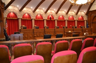 The Supreme Court courtroom in the basement of Library of Congress in Washington, DC was the inspiration for much of the design.