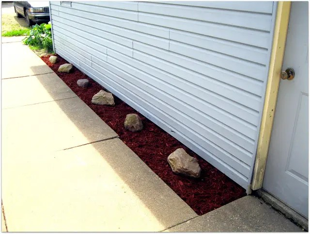 DIY Outdoor Inspiration:  Mini Makeover Using Fabric Landscaping and River Rocks