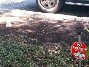 """red sign for a """"Pet Stop"""" electronic fence"""